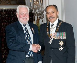 Bud being congratulated by Governor General Jerry Mateparae on being awarded the QSM